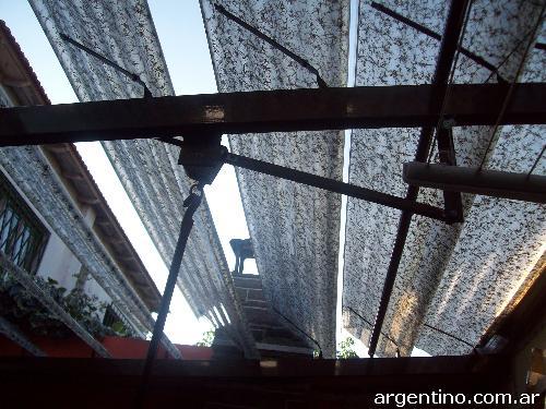 Fotos de tolcer toldos de aluminio poli ster y for Materiales para toldos de aluminio