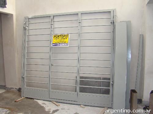 Portones de garaje en campana tel fono direcci n y p gina web Portones de garaje