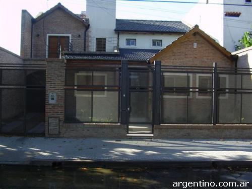 Giuga herrer a de obra portones aberturas cerramientos for Portones de aluminio en rosario