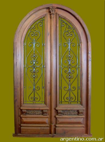 Puerta doble hoja de entrada medio punto en madera en - Puertas de aluminio doble hoja ...