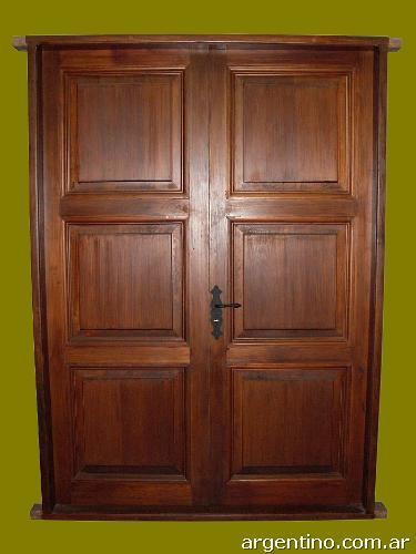 Puerta de entrada doble hoja ciega en madera con tableros for Puertas dobles de madera modernas
